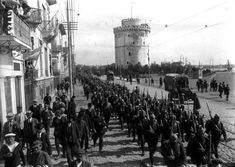 """"""" November 1916 - Greek Provisional Government Declares War on Germany and Bulgaria Pictured - Nationalist Greek soldiers march to the front, past the White Tower of Thessalonika. The Greek Provisional Government's declaration of. Thessaloniki, World War I, Old World, Hellenic Army, King George I, Greek Soldier, London Today, History Of Photography, In Ancient Times"""