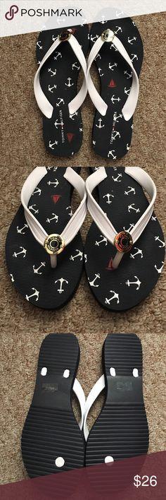 Tommy Hilfiger fashion flip flops! Tommy Hilfiger flip flops. Never worn. Navy blue and white. Anchor details all around. Gold TH emblem. Tommy Hilfiger Shoes Sandals