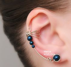Silver and Petrol Color Dragonfly Wings Cuff Earrings - Genuine Swarovski Pearls, tarnish resistant wire. $15.65, via Etsy.