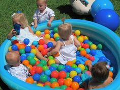 Fill a kiddie swimming pool with balls for a fun outdoor activity.