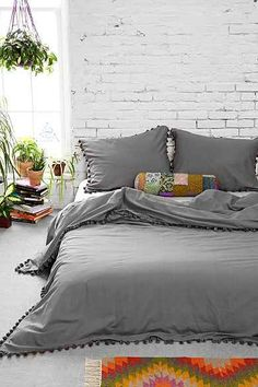 Magical Thinking Pom-Fringe Duvet Cover This is seriously perfect for my bedroom Dream Bedroom, Home Bedroom, Bedroom Decor, Bedrooms, Decor Room, Master Bedroom, Duvet Covers Urban Outfitters, Style Deco, Grey Bedding
