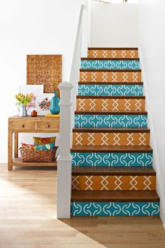 blue orange stairs. and for under the stairs, with the books