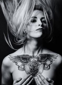 Awesome tattoo chest piece on this lady. It`s a memorial tattoo.