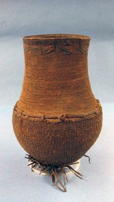 Africa | Basketry jar, most probably from Somalia or Nubia | Natural fiber (coiled) and leather.