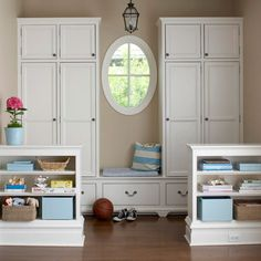 With room for every member of the family, this mudroom spreads function and style along an entire wall. The cupboards along the back wall keep clutter to a minimum. Half-wall shelving units in front of the nook define the mudroom area and also act as a barrier between clutter and the adjacent spaces.