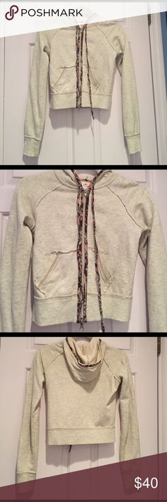 Free People Zip-Up Hoodie Extremely cute FP sweatshirt, perfect to wear alone or with a shirt underneath. Has two zippers so can be unzipped from the bottom one as well. Small stains on the left sleeve but very minimal Free People Tops Sweatshirts & Hoodies
