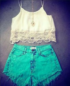 Blue green high-waisted shorts and white crop top