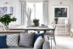 Open plan living and dining area with blue decor accents in a family-friendly home designed by Sims Hilditch Create A Family, Interior Decorating, Interior Design, Room Planning, Open Plan Living, Upholstered Furniture, Beautiful Interiors, Soft Furnishings, Living Room Furniture