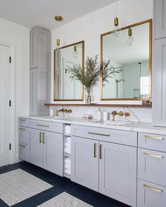 Light grey cabinets complementing brass fixtures in modern master bathroom. the 😍😍😍Featuring Parachute towels. via Homepolish. Bad Inspiration, Bathroom Inspiration, Bathroom Interior Design, Home Interior, Modern Bathroom Design, Light Gray Cabinets, Grey Bathroom Cabinets, Brass Bathroom Fixtures, Bathroom Pendant Lighting
