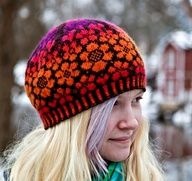 Fair isle knitted hat. Do not like these colors--something soft like grey and white.