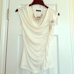 Body Central Ivory Gathered Blouse This top is so cute! It has a draped neckline and is gathered on the left side. It is super lightweight and semi sheer. It has a removable tulle flower pendant on the left side that is embellished with pearls. Body Central Tops Blouses