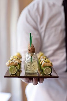 Mini tacos served with little Patron bottles.