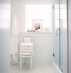 Clean white bathroom design! White subway tiles backsplash, white carrara marble hexagon tiles floors, subway tiles backsplash.