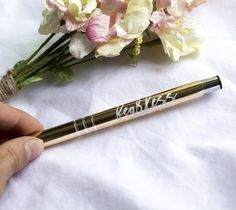Our Fearless pen is so smooth to write with and the perfect accessory to  your home or office. It is a triple classic click ballpoint pen with black  medium ink  This stylish click pen features a champagne metallic finish colored barrel  with silver trim and the word fearless in script writing laser printed on  the side.