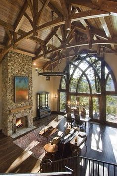 Fireplace with gothic picture windows.