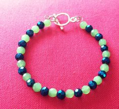 Hey, I found this really awesome Etsy listing at https://www.etsy.com/listing/183960365/pretty-green-blue-faceted-beaded