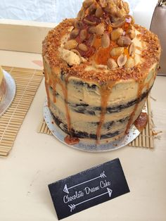 Naked cake. My own creations  Chocolate sponge soaked with vanilla syrup covered with salted caramel buttercream and topped with shards of salted peanut praline and drizzled with brandy caramel sauce