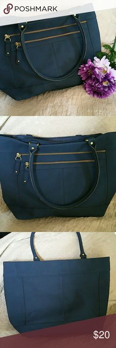 Merona Shoulder Handbag NWOT. Gorgeous Denim blue colored Merona Shoulder handbag. Two outside zippered Pockets one large zippered inside compartment with small zippered pocket inside plus pockets for cell phone or other accessories. Metal zippers.  Measures  11Lx10.5Hx5W in inches. Merona Bags Shoulder Bags