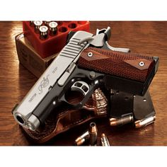 Kimber 1911- the perfect mix of ultra hot and ultra badass. Kinda like Jason Bourne. That's right.
