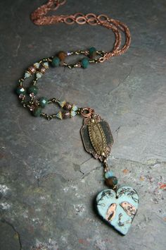 Lovely piece by Erin Prais-Hintz using Humblebeads focal and stampings from B'Sue Boutiques