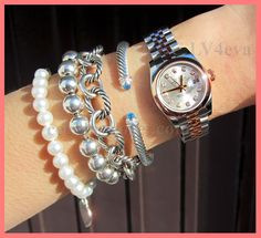 Left to right: Tiffany pearl bracelet with heart tag Tiffany silver bead bracelet David Yurman Oval Links bracelet David Yurman Classic Cable bracelet Rolex Oyster Perpetual watch