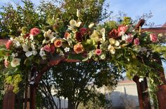 This is a beautiful Bohemian wedding arch swag for your ceremony or to use on your fireplace mantle. This ceremony swag has Beautiful off white Japanese magnolias, english roses, Eucalyptus, Ivy, coral ranunculus and Olive Greens and thistle.  This s arch is approx 5 wide and 12 deep on average. You can keep this afterwords in your home as it is all silk and will keep with minimal cleaning. We can build larger if you prefer please convo me for your needs.  You can also order two tie backs to…