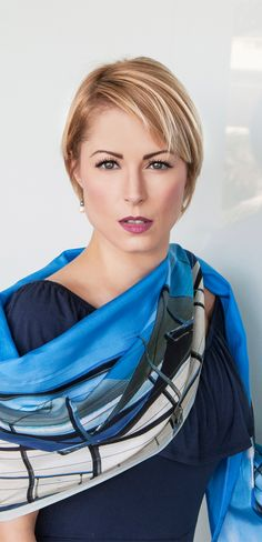 Blue silk scarf Mooloo View by Seahorse Silks makes a stunning wrap over a navy off the shoulder dress.