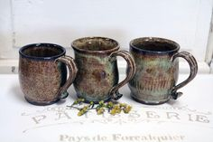 These mugs are hand thrown on the wheel with dark clay. They are earthy green an. Pottery Mugs, Ceramic Pottery, Pottery Ideas, Grandma Mug, Wheel Thrown Pottery, Do It Yourself Crafts, Handmade Pottery, Handmade Ceramic, Ceramic Mugs