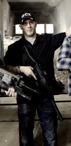 Tom and guns...oh my this is so hot, especially since he knows how to handle his firearm properly..haha
