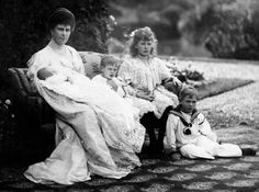 Then Princess Mary of Teck, the Princess of Wales, (later Queen Mary) with her children: infant (Prince John), Prince Henry, Princess Mary, Prince Albert (later King George VI)