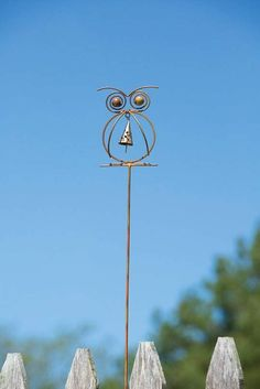 Beauty, or brains? Who says you can't have both! This Owl With Bell Garden Stake is as adorable as he is wise, and he's going to look absolutely brilliant in your garden. Sculpted from stout wire and finished in a glowing, flame finish, you'll love the gentle melodies this piece brings to your outdoor space.  #gardening #gardenart #gardendecor #GardenStakes #Gardenstake #gardening #gardenlover #gardenart Garden | Gardening | Garden Art | Garden Decor | Garden Stake Garden Owl, Garden Ideas, Bell Gardens, Metal Yard Art, Metal Art, Asian Garden, Organic Gardening Tips, Vegetable Gardening, Garden Stakes