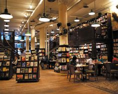 (Housing Works Used Book Cafe in New York is operated by volunteers, & the profits are used exclusively to help the homeless & people with HIV/AIDS. The welcoming environment has towering b… Arranging Bookshelves, Decorating Bookshelves, Library Cafe, Library Books, Housing Works, Book Cafe, Store Interiors, Planet Books, Market Stalls