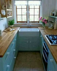 Sweet turquoise small kitchen