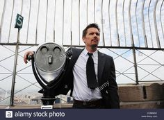 Download this stock image: Oct. 28, 2010 - Manhattan, New York, U.S. - ETHAN HAWKE, Academy-Award nominated actor and philanthropist lights the Empire State Building blue to celebrate the ''Men In Blue'' of The Doe Fund's Ready, Willing and Able program. (Credit Image: © Bryan Smith/ZUMApress.com) - CCMMGX from Alamy's library of millions of high resolution stock photos, illustrations and vectors.