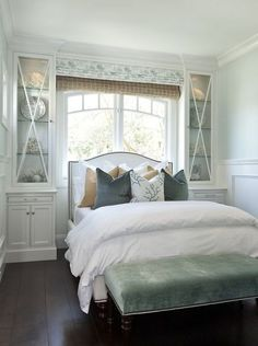 Sometimes you need to get creative with storage and furniture layout in tight beach house rooms. Built-ins take the place of nightstands in this bedroom, and centering a bed beneath a window is the best use of the space.