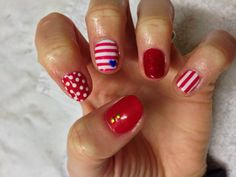 CND Shellac Nail Art - Nautical themed manicure in Hollywood red, Ruby Ritz glitter, Cream Puff white, Water Park blue heart and 1.5mm gold round studs.