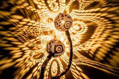 Artist Vainius Kubilius drills coconuts into lamps that shine gorgeous patterns of lights. #craft #art