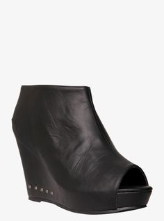 """At once edgy and sophisticated (can you say """"hello, studs?""""), our black peep-toe bootie with a sculpted wedge makes a real entrance whether under denim or a dress."""