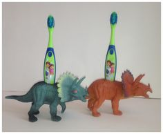 Any plastic toy that they love...get a second, drill holes to hold the toothbrushes and VOILA' - Now they brtush. Set a cool timer for a minute to make sure they do it long enough. o.k?  All This For Them: Dinosaur Tooth Brush holders