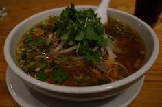 Republic - Spicy Beef Noodle Soup, broth noodles with wheat noodles, rare beef, garlic, onion, lemongrass, chili peppers, scallions, sprouts, and cilantro