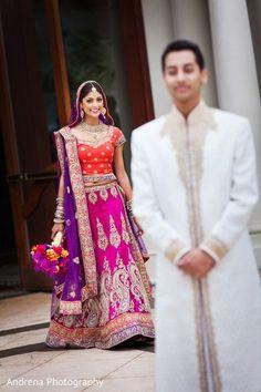 Indian wedding photography. Couple photo shoot ideas. Candid photography. Indian bride wearing bridal lehenga and jewelry. #IndianBridalHairstyle #IndianBridalMakeup