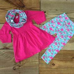 The Vintage Rose Floral 3-Pc Boutique Outfit is totally trendy and super cute! The long sleeve hot pink tunic, light blue & rose print leggings, and matching infinity scarf are made of soft cotton and