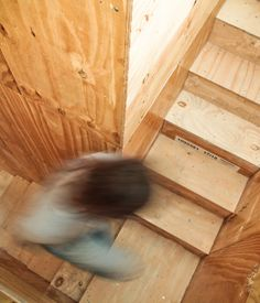A closer look at the reclaimed wood cladding the central cube and staircase.