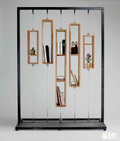 """A remanier pour faire une """"partition"""" sur roulettes The lack of space for books is so astonishing that I cannot in good conscience call it a bookshelf, but it is an innovative and attractive decoration. Perhaps a room divider or window screen of sorts. Home Design, Decoration Evenementielle, Book Storage, Art Storage, Storage Shelves, Storage Ideas, Display Design, Shelf Design, Visual Display"""