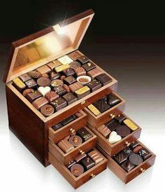 My idea of a jewelry box.of course diamonds sapphires , emeralds & rubies underneath the chocolates would make it perfect. Chocolate Bonbon, Chocolate Dreams, Chocolate Delight, Death By Chocolate, Chocolate Sweets, I Love Chocolate, Chocolate Heaven, Chocolate Shop, Like Chocolate