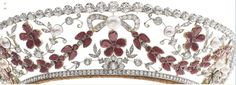 A close up of the Rosenborg tiara, highlighting the diamond foliate scrolls, garnet swags and button pearls.