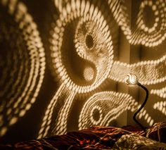 I use coconut, corks and suede to create lamps that dominate the room. Handcrafted lamps look like shiny jewels and light patterns make you want to stare at a wall like you would stare at clouds or stars.