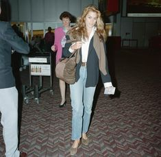 From Suzy Parker in the to Kaia Gerber today, the best supermodel airport styles to try from across the decades. Iman And David Bowie, 90s Mom Jeans, Suzy Parker, Carolyn Bessette Kennedy, Richard Gere, Kaia Gerber, Leather Blazer, Cindy Crawford, Tweed Jacket