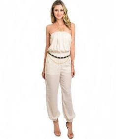 Description Strapless jumpsuit features a blouson bodice, chain link belt, dropped inseam and gathered pant cuffs. 100% Polyester