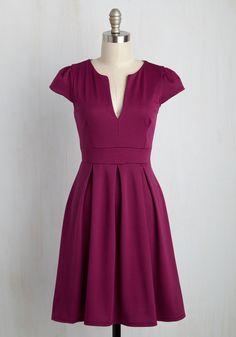 Delight taste-testers left and right as you dole out your perfectly blended punch in this deep-magenta dress. With a V-notched neckline and pleated, flared skirt, this cap-sleeved frock makes you feel as effervescent as your carefully crafted libations.